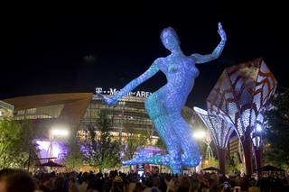 The Bliss Dance sculpture by artist Marco Cochrane is officially illuminated Monday, April 4, 2016, at The Park. The new pocket park, lined with restaurants and seating for outdoor dining, runs from the Las Vegas Strip to the new T-Mobile Arena.