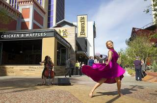 A dancer performs during the grand opening of The Park Monday, April 4, 2016. The new pocket park, lined with restaurants and seating for outdoor dining, runs from the Las Vegas Strip to the new T-Mobile Arena.
