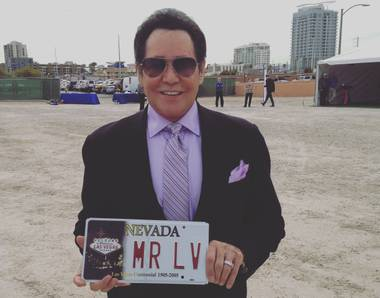 Wayne Newton holds a commemorative license plate presented to him Thursday, April 7, 2016, by Gov. Brian Sandoval at Project Neon in Symphony Park downtown.