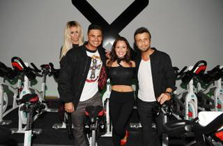 Aubrey O'Day, DJ Pauly D, Jennifer Barnet and Larry Rudolph attend the grand opening of Xcycle on Saturday, April 9, 2016, in Boca Park.