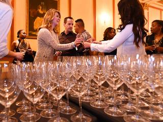 Wine glasses are handed out to attendees during the 42nd annual UNLVino Grand Tasting event at Paris Las Vegas Saturday, April 16, 2016.