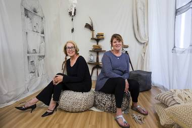 "Artists Diane Butner, left, and Kathleen Nathan pose in the ""Reading Room"" at Nest Studio, 1800 S. Industrial Rd., Sunday, April 17, 2016."