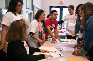 Organizers troubleshoot problems during a citizenship drive workshop at the Painters Union on Saturday, April 16, 2016. Organizers have set a goal of helping 2,500 legal resident immigrants apply for citizenship this year.