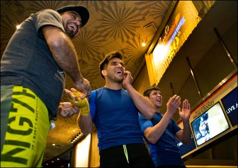 Flyweight Henry Cejudo shares a laugh while being taped up during a UFC 197 open workout with his team at the MGM Grand on Wednesday, April 20, 2016.