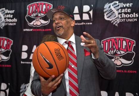 New UNLV basketball coach Marvin Menzies appears before the media and invited guests sporting new hat and ball after the Nevada Board of Regents approved his contract on Friday, April 22, 2016.