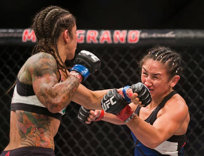 Womens Strawweight Juliana Lima strikes the face Carla Esparza during ...