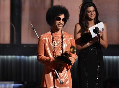 In this Feb. 8, 2015, file photo, Prince presents the award for album of the year at the 57th annual Grammy Awards in Los Angeles. Beyond dance parties and hit songs, Prince's legacy included black activism. He said black lives matter before presenting a 2015 Grammy.