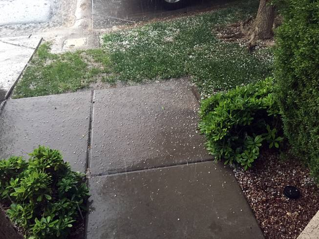 Pebble-sized hail is shown in the Gibson Springs area of Henderson, Thursday, April 28, 2016.