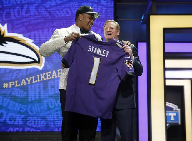 Notre Dame's Ronnie Stanley poses for photos with NFL Commissioner Roger Goodell after being selected by Baltimore Ravens as the sixth pick in the first round of the 2016 NFL football draft, Thursday, April 28, 2016, in Chicago.