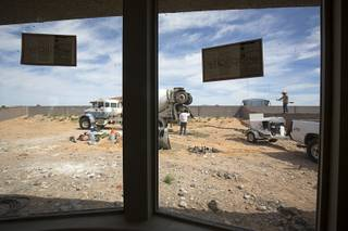 Landscapers build a block wall in the backyard of a home under construction at the Valley Heights by Elation Homes subdivision Wednesday, May 4, 2016, in Moapa Valley.