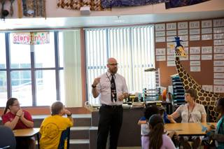 Ryan Dwyer, a full-time teacher and certified CCSD Librarian, teaches class at Kay Carl Elementary School, Friday May 13, 2016.