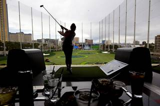 Allie Romer drives off the third level during friends and family day at Topgolf Las Vegas Tuesday, May 17, 2016. Topgolf Las Vegas, the company's flagship property, will open to the public at 8 a.m. Thursday.