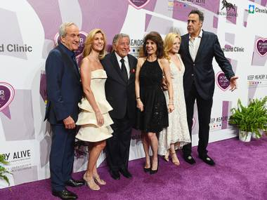 From left Co-Founder and Chairman of Keep Memory Alive Larry Ruvo, Susan Benedetto, honoree Tony Bennett, Co-Founder/Vice-Chairman of Keep Memory Alive Camille Ruvo, Isabella Quella and comedian Brad Garrett appear on the red carpet for Keep Memory Alive's 20th Annual Power Of Love Gala at the MGM Grand Garden Arena on May 21, 2016, in Las Vegas.