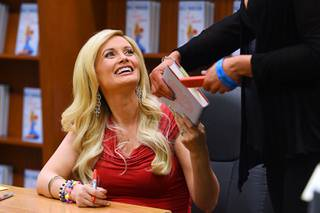 Holly Madison smiles during a book signing to promote her new book