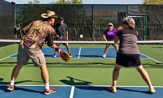 Members with the Sun City Anthem Pickleball Club battle on the courts at Liberty Center on Wednesday, May 25, 2016.