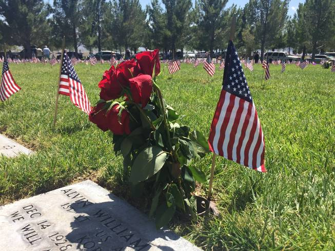 Roses decorate a grave marker at the Southern Nevada Veterans Memorial Cemetery on May 30, 2016. Flowers and American flags were placed at the grave markers in the cemetery over Memorial Day weekend by family members and the Veterans of Foreign Wars.