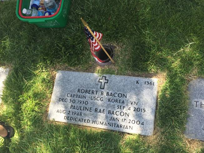 "The grave marker of Robert Bacon, a Korean War veteran who died in 2015, and Pauline Bacon, a ""dedicated humanitarian,"" is pictured Monday, May 30, 2016 at the Southern Nevada Veterans Memorial Cemetery."