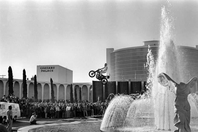 Evel Knievel attempts to jump the fountains at Caesars Palace on Dec. 31, 1967, in Las Vegas. Knievel's attempt came up short, and he crashed upon landing, suffering a crushed pelvis and femur, fractures to his hip, wrist and both ankles and a concussion that kept him in a hospital.