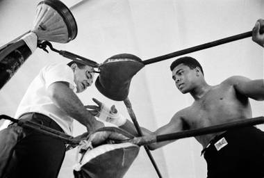 World heavyweight champion Muhammad Ali gets his hand taped by his manager Angelo Dundee before a sparring session Oct. 13, 1966, in Miami. Ali meets Doug Jones in Louisville on Oct. 27 in a charity bout, then puts his title on the line in Houston on Nov. 14 against Cleveland Williams.