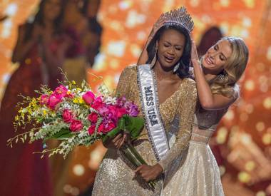 Miss District of Columbia Deshauna Barber is crowned Miss USA during the Miss USA Pageant at T-Mobile Arena on Sunday, June 5, 2016, on the Las Vegas Strip. 2015 Miss USA Olivia Jordan is at right.