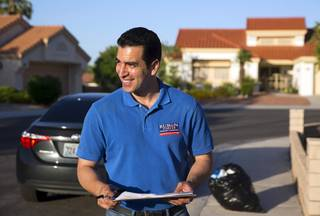 Congressional candidate Ruben Kihuen canvasses in a neighborhood in Summerlin Monday, June 6, 2016.