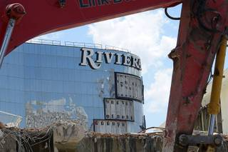 A backhoe frames the front of the Riviera Saturday, June 11, 2016, as the its Monaco tower is readied for implosion Tuesday morning. The Las Vegas and Convention Authority purchased the Riviera as part of their expansion plans.