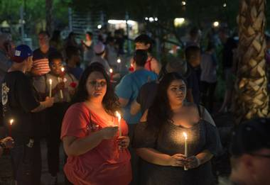 Tamara Crevison and Megan Ortiz hold candles during a vigil and call to action at the Gay & Lesbian Community Center of Southern Nevada on Sunday, June 12, 2016, in Las Vegas. The event was a show of solidarity and support after Sunday morning's mass shooting at Pulse nightclub in Orlando, Fla., where at least 50 patrons were killed and 53 injured.