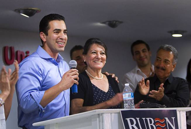 Democratic Congressional candidate Ruben Kihuen introduces his mother Blanca, a Culinary Workers Union member, and father Armando, right, at the Culinary Workers Union, Local 226, headquarters Tuesday, June 14, 2016.