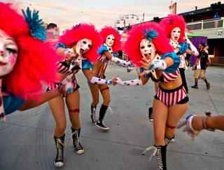 Colorful characters greet attendees during the first night of the Electric Daisy Carnival on Friday, June 17, 2016, at Las Vegas Motor Speedway.