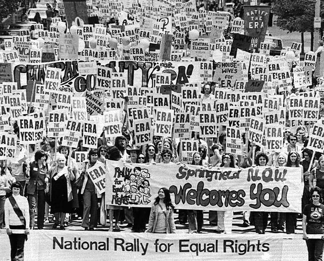 Thousands march in Springfield, Ill., on May 16, 1976, to support the passage of the Equal Rights Amendment. Six years later, the amendment's June 30 deadline passed without ratification. Only 35 states, three short of those necessary, endorsed it.