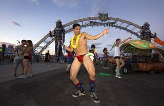 Christopher Ysais of Houston, Texas, dances by the entrance to Kinetic Field during the third night of the Electric Daisy Carnival on Sunday, June 19, 2016, at Las Vegas Motor Speedway.