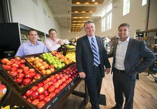 Raintree Investment executives pose during the official opening of the Seasons Market at Lake Las Vegas in Henderson Tuesday, June 21, 2016. From left: Jeff Anderson, excutive vice president, Doug McPhail, Seasons Market general manager, Patrick Parker, president, and Cody Winterton, executive vice president. The neighborhood grocery store and specialty market is located in MonteLago Village.
