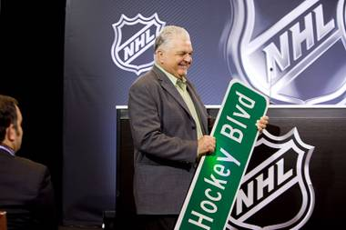 Clark County Commission Chairman Steve Sisolak arrives with customized road signs at a NHL news conference at the Encore Wednesday, June 22, 2016. Sisiolak gave a sign to new franchise owner Bill Foley, left, and NHL Commissioner Gary Bettman, he said.