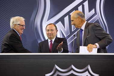 New franchise owner Bill Foley, left, is welcomed onstage by Gary Bettman, center, NHL commissioner, and  NHL Board of Governors Chairman Jeremy Jacobs during a news conference at the Encore Wednesday, June 22, 2016. The NHL expansion team is expected to begin play in the 2017-18 season at T-Mobile Arena.