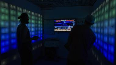 Attendees play a video game during the Small Space Fest at Emergency Arts downtown Las Vegas, Monday, June 20, 2016.