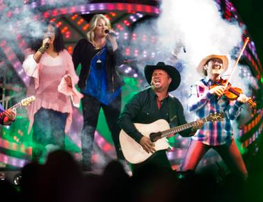 Garth Brooks takes the stage to perform with his band at the T-Mobile Arena on Friday, June 24, 2016.