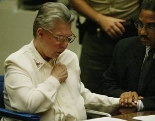 Convicted murderer Sante Kimes, 71, clutches the hand of her attorney Ray Newman as she is found guilty of the first-degree murder of David Kazdin, Wednesday, July 7, 2004, in a Los Angeles County Superior Courtroom. Kimes, who along with her son Kenneth Kimes have already been convicted of killing an elderly New York socialite, was found guilty of orchestrating the murder of David Kazdin.