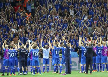 Iceland players celebrate with their supporters at the end of the Euro 2016 round of 16 soccer match between England and Iceland, at the Allianz Riviera stadium in Nice, France, Monday, June 27, 2016.
