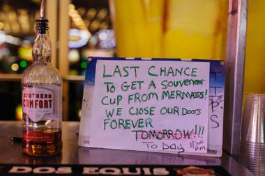 A handwritten sign adorns a bar outside Mermaids, during the last night of operation on Monday, June 27, 2016. The casino closed its doors at eleven along with La Bayou and Glitter Gulch.
