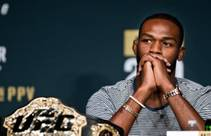UFC 200 fighter Jon Jones ponders his opponent Daniel Cormier during a reporter's question at a news conference and face-off for the final time at ...