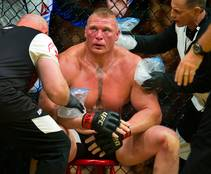 Brock Lesnar is cooled off between rounds with Mark Hunt during UFC 200.