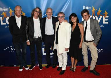 "Cirque du Soleil CEO Daniel Lamarre, in white suit, appears with others at a red carpet event for the Beatles ""Love"" 10th anniversary celebration, Thursday, July 15, 2016."