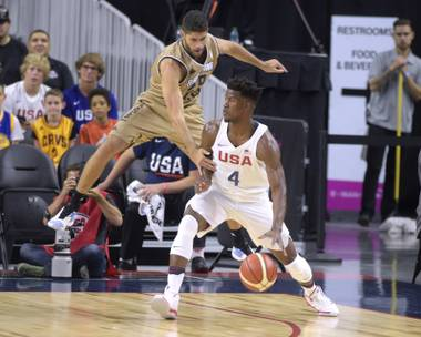 Jimmy Butler of the United States is defended by Patricio Garino of Argentina during a USA Basketball showcase exhibition game at T-Mobile Arena Friday, July 22, 2016, in Las Vegas, Nevada. The United States won 111-74.