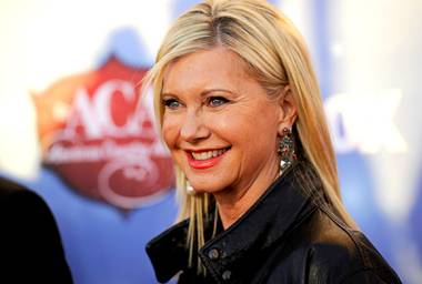 In this Tuesday, Dec. 10, 2013, file photo, Olivia Newton-John arrives at the American Country Awards at Mandalay Bay in Las Vegas.