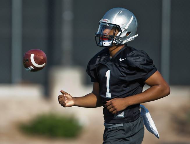 UNLV's QB Armani Rogers tosses the ball as football practice begins during their fall camp on Friday, Aug. 5, 2016.