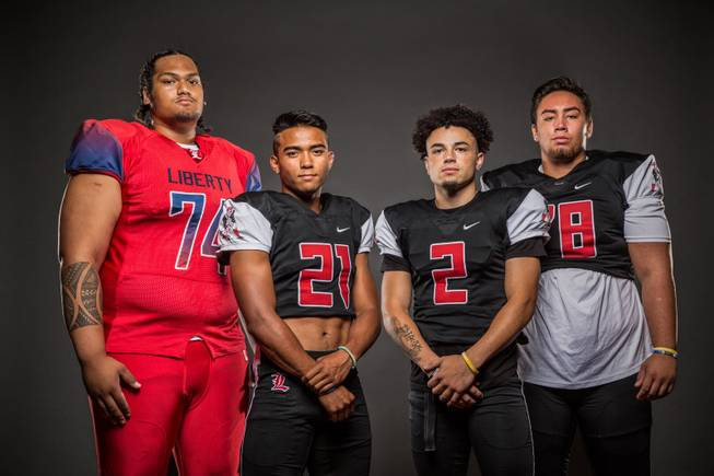 Members of the Liberty High football team pose for a photo at the Las Vegas Sun's high school football media day July 20, 2016 at the South Point. They include, from left, Malaesala Aumavae-Laulu, Darion Acohido, Ethan Dedeaux, and Will Brewer.