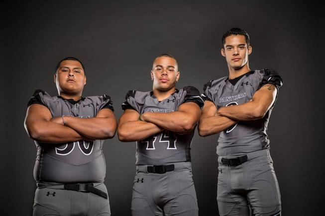 Members of the Palo Verde High football team pose for a photo at the Las Vegas Sun's high school football media day July 20, 2016 at the South Point. They include, from left, Stephen Garcia, Maxie Miller-Hooks, and Tyler Thornton.