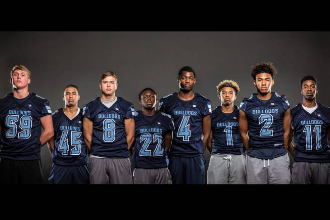 Members of the Centennial High football team pose for a photo at the Las Vegas Sun's high school football media day July 20, 2016 at the South Point. They include, from left, Jacob Kelly, Marvin Perkins Jr., Jacob Arsen, Kayuon Miller, J.J. Johnson, Bryce Hamton, Jamaal Evans, and Savon Scarver.