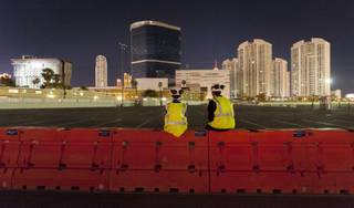 Gino Catania, left, and his cousin Vinny Catania wait on a barrier for the implosion of the remaining tower of the Riviera Hotel & Casino, far left, along with the property's remaining structures early Tuesday August 16, 2016 in Las Vegas. Northstar Contracting Group held an employee event for the implosion in the adjoining Gold parking lot of the Las Vegas Convention Center. CREDIT: Mark Damon/Las Vegas News Bureau
