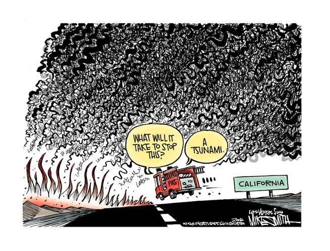 California fire truck heading towards wild fire.  Fireman says,